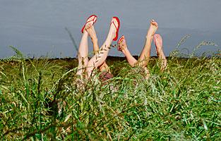 legs_in_air_grass